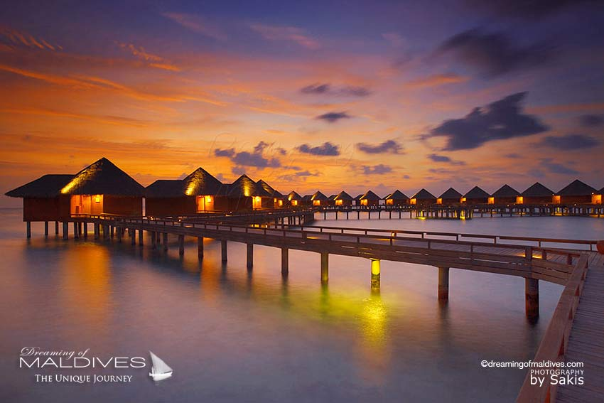 Baros Maldives sunset water villa
