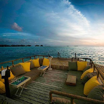 Gili Lankanfushi Maldives best Moment and Place ounge on the floating Chill Deck in the middle of the sea