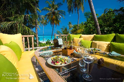 Gili Lankanfushi Maldives - The 360 Table surrounded by lounge benches and huge colourful pillows