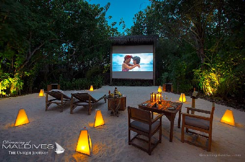 Gili Lankanfushi Maldives Dinner at The Jungle Cinema watch your favorite movie under the stars and enjoy a private tailored Dinner.