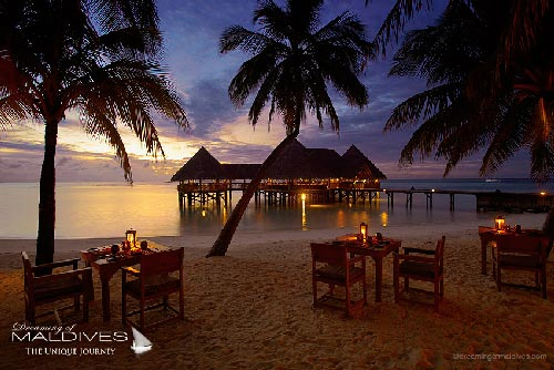 Gili Lankanfushi Maldives - Sand-floor main restaurant is widely open on the beach with large alcoves and tables set inside or in front of the lagoon