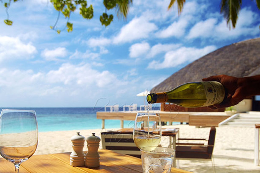 Huvafen Fushi Maldives Fogliani Restaurant and pizzeria is settled on the beach, under the palm trees