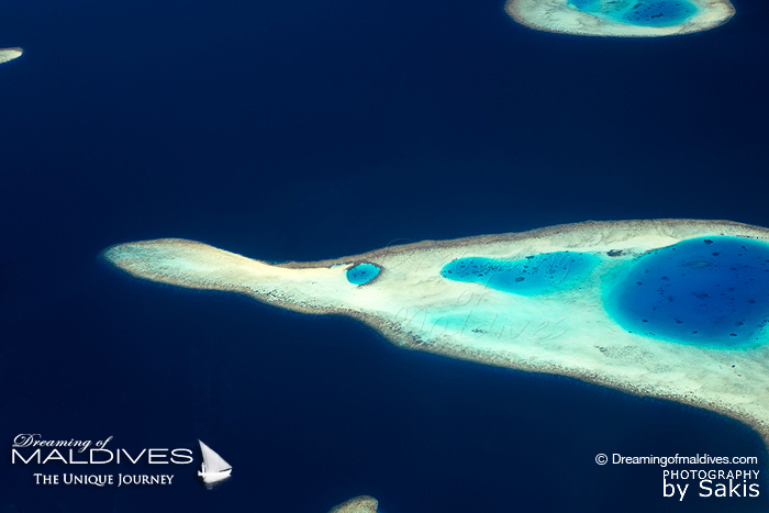 Photo of Maldives - Aerial View of the Maldives Islands. Fish Shape