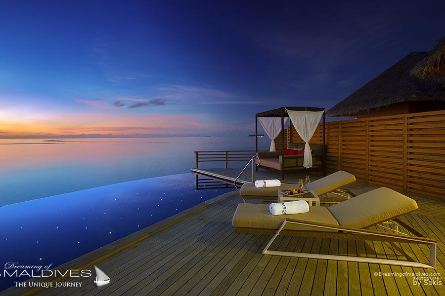 Baros Maldives Water Pool Villa at night