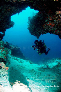Diving in one of the many caves that the Atoll has to offer, including one of the famous spot called Nassimo Thila