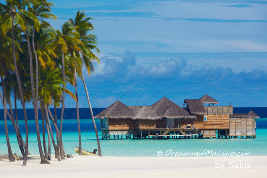 Gili Lankanfushi Maldives The Crusoe Residences and its private boat from the beach