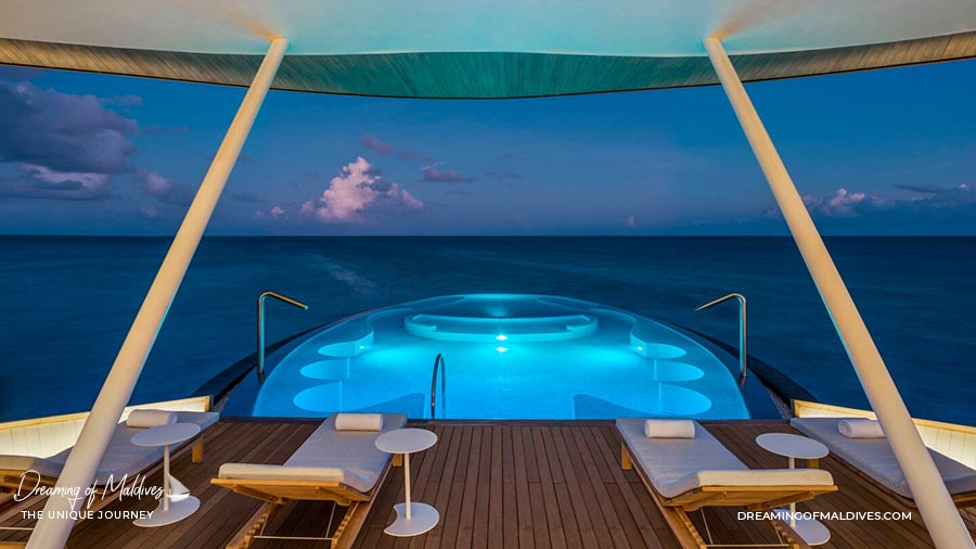 The Amazing Blue Hole Pool at night. Iridium Spa St Regis Vommuli Maldives