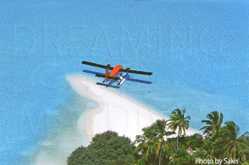Aerial photography Maldives- Zoom on a seaplane anchored on a desert island