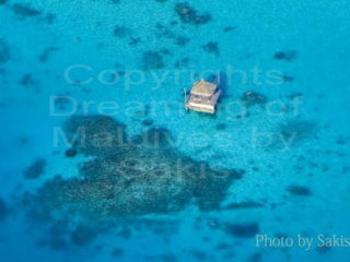Maldives aerial photo of a private deck in the lagoon