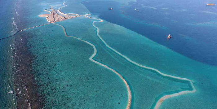 Dredging for land reclamation in Maldives.
