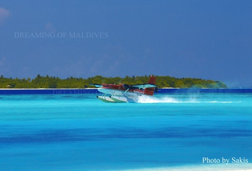 seaplane landing on a reort lagoon in Maldives