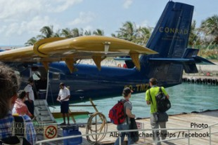 Michael Phelps boarding on the seaplane to reach his Island at Conrad Maldives Rangali