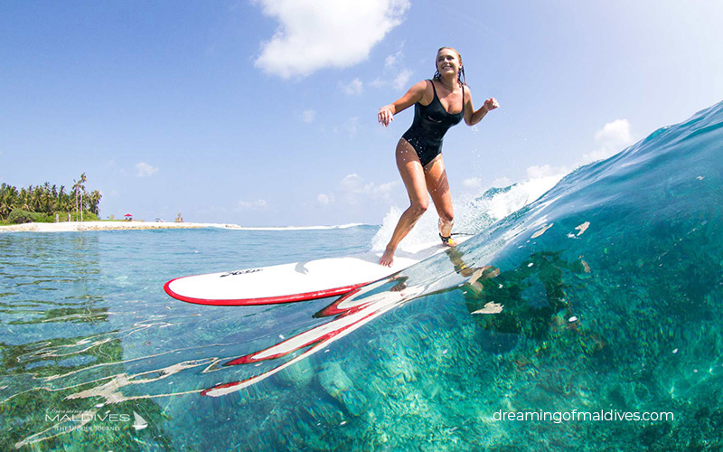 Surfing at Vodi Spot. Niyama Maldives. Dhaalu Atoll