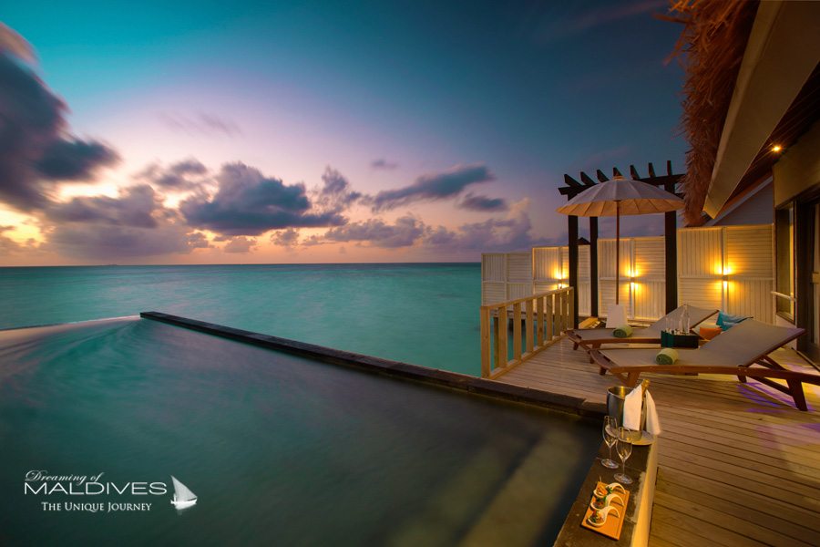 Ozen at Maadhoo Maldives. Water Villa Deck at Sunset