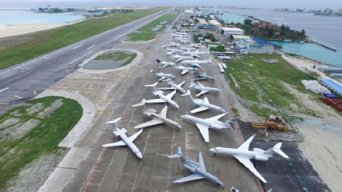 Busy Tarmac at Velana Airport. Private Jets are legion.