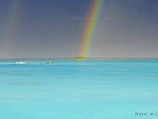 Rainbow over an island in Maldives