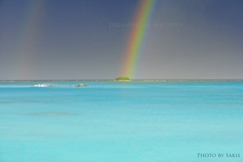 Rainbow over an island in Maldives