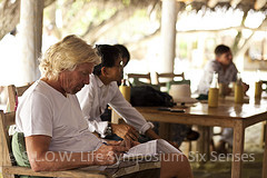 Sir Richard Branson studying at the Slow life Green symposium