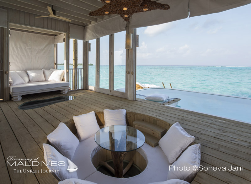 Soneva Jani water villa lounge and dining are