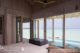 Soneva Jani water villa master bedroom with lagoon view