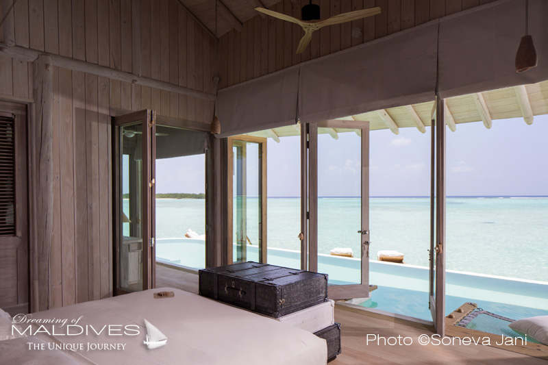 Soneva Jani water villa master bedroom with lagoon view