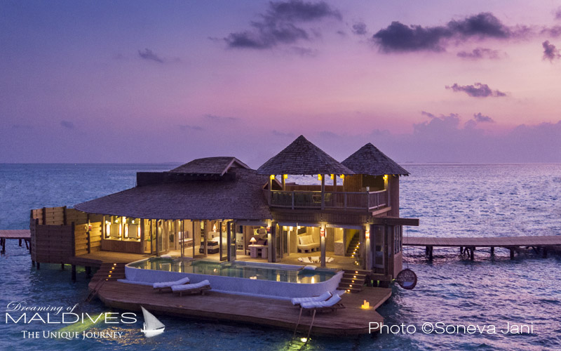 Soneva Jani water villa at sunset