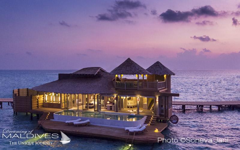 Soneva Jani water villa at sunset