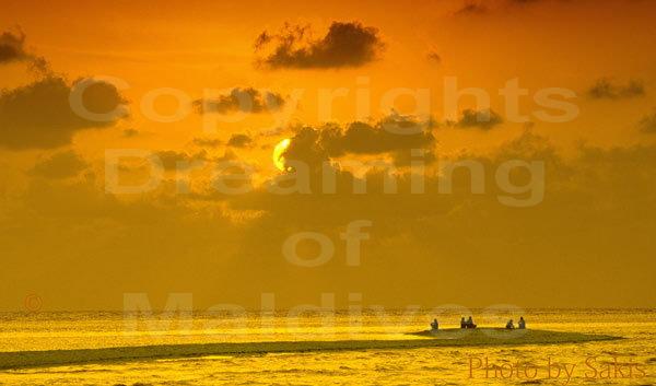 Sunset on a sandbank in Maldives