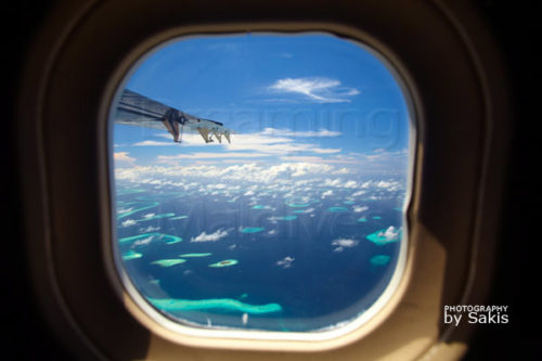 window seat with a dreamy aerial view on the Maldives Islands
