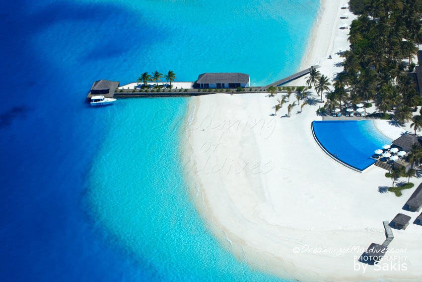 Velassaru Maldives - Resort Aerial View. Arrival Jetty and Infinity Pool