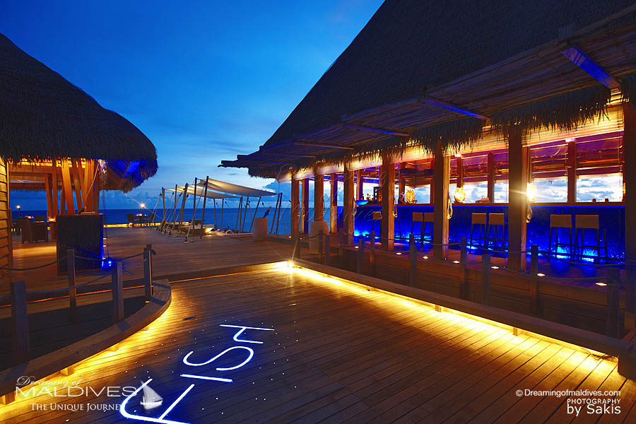 W Maldives Fish restaurant Entrance at Dusk and SIP Bar on the right