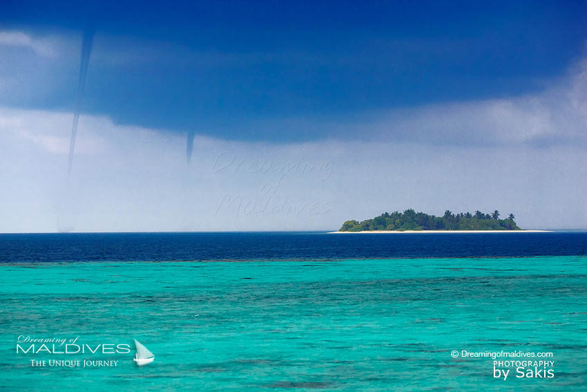 Maldives severe Weather - 2 small tornadoes or Water Spouts on the lagoon. 2011 rainy season